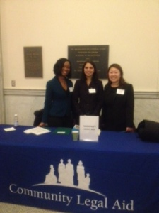 Weyonnoh Nelson-Davies, Mehda Makhlouf, and I answering questions at the Community Legal Aid table at the State House.